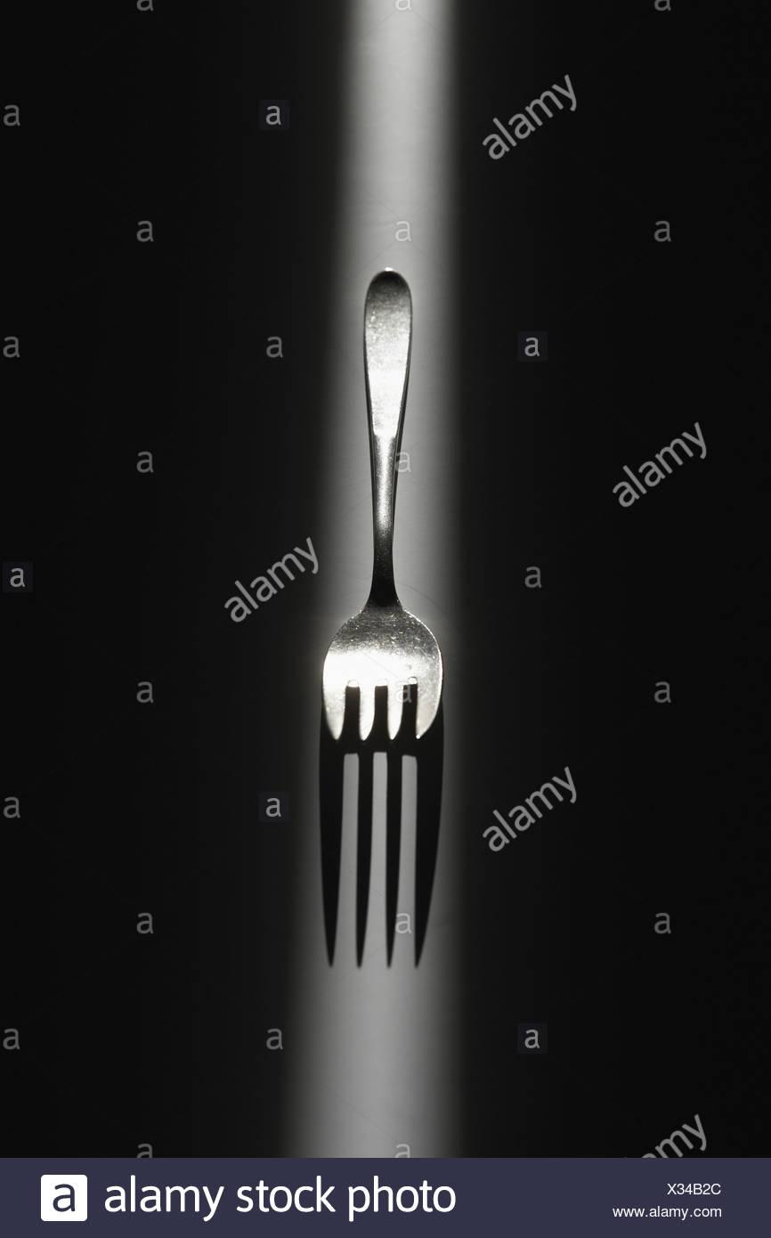 Gabel auf schwarzem Hintergrund Stockbild