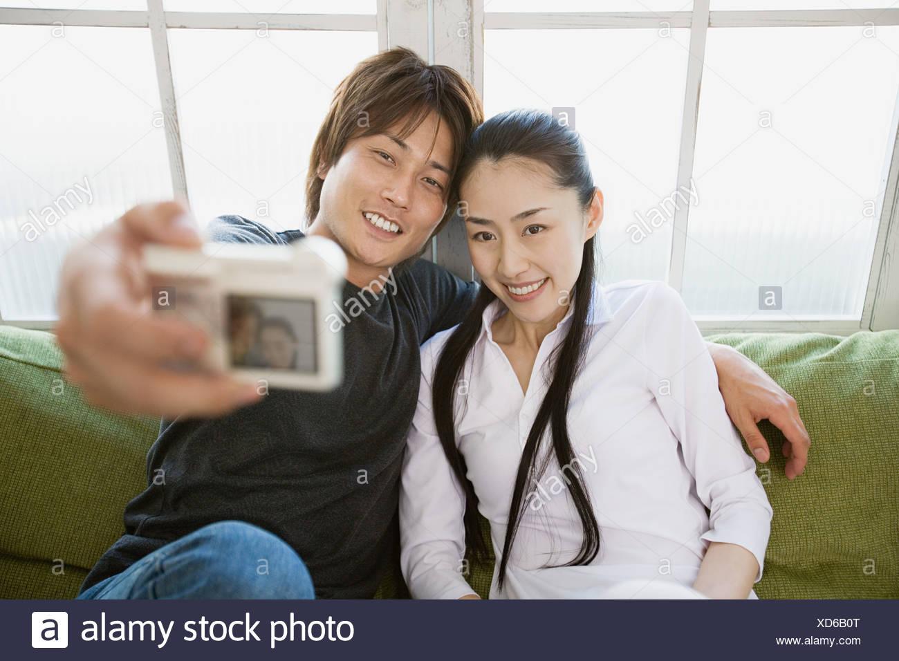 Paar, ein Bild von sich selbst Stockbild