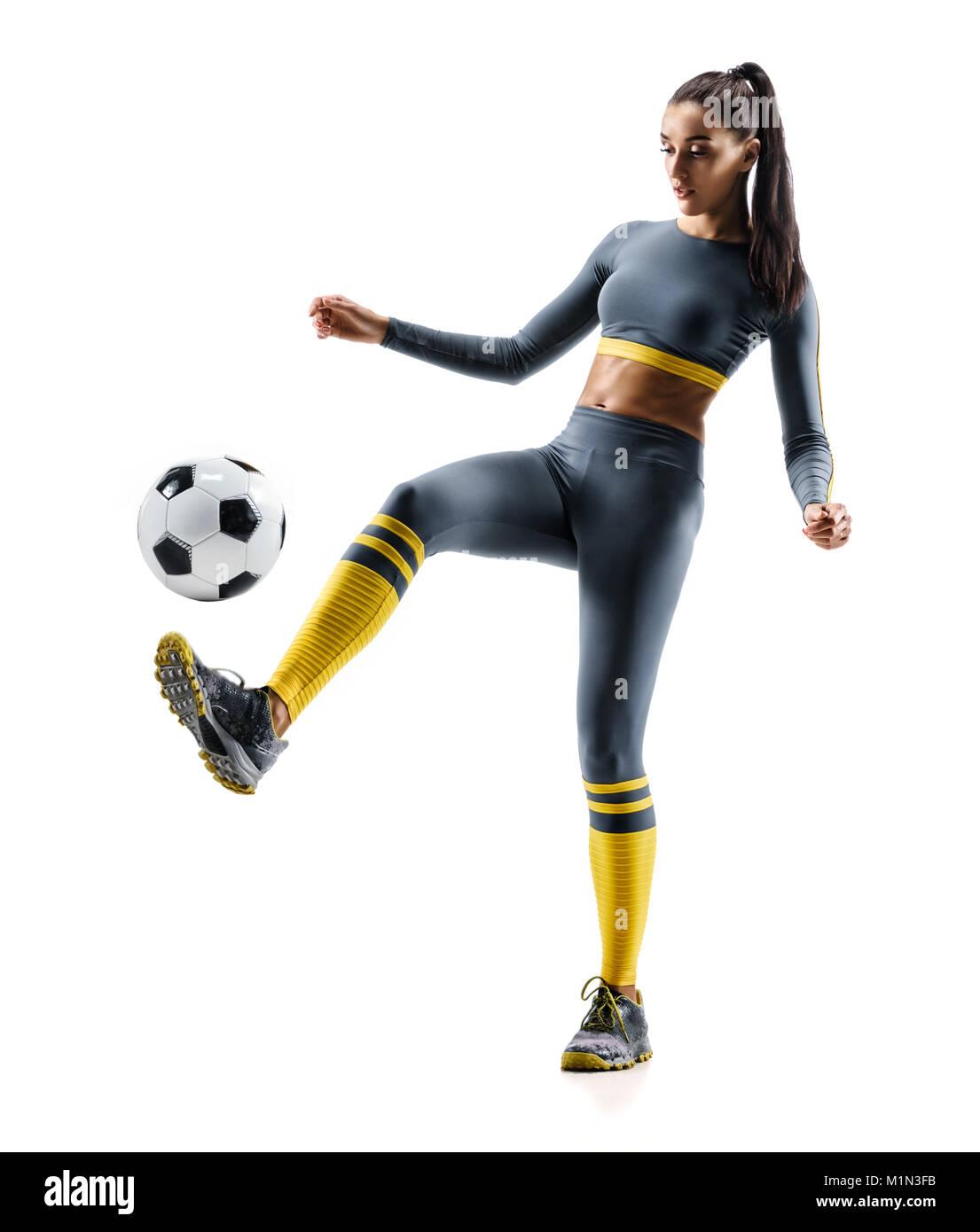 Jugador de fútbol en acción. Foto de mujer deportiva en ropa deportiva  aislado fondo blanco. Movimiento dinámico. d322417bbd4d4