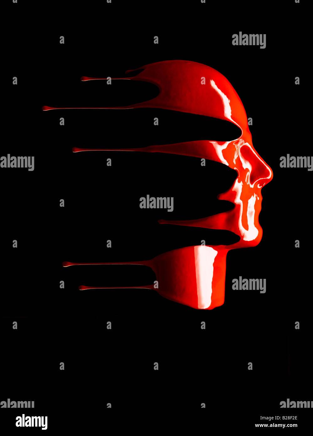 Liquide rouge dégoulinant d'un visage. Photo Stock