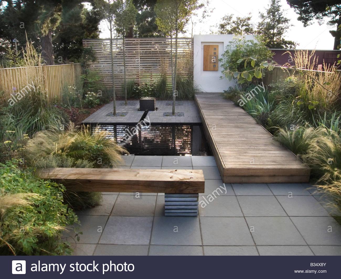 jardin urbain contemporain avec banquette lit pont de l