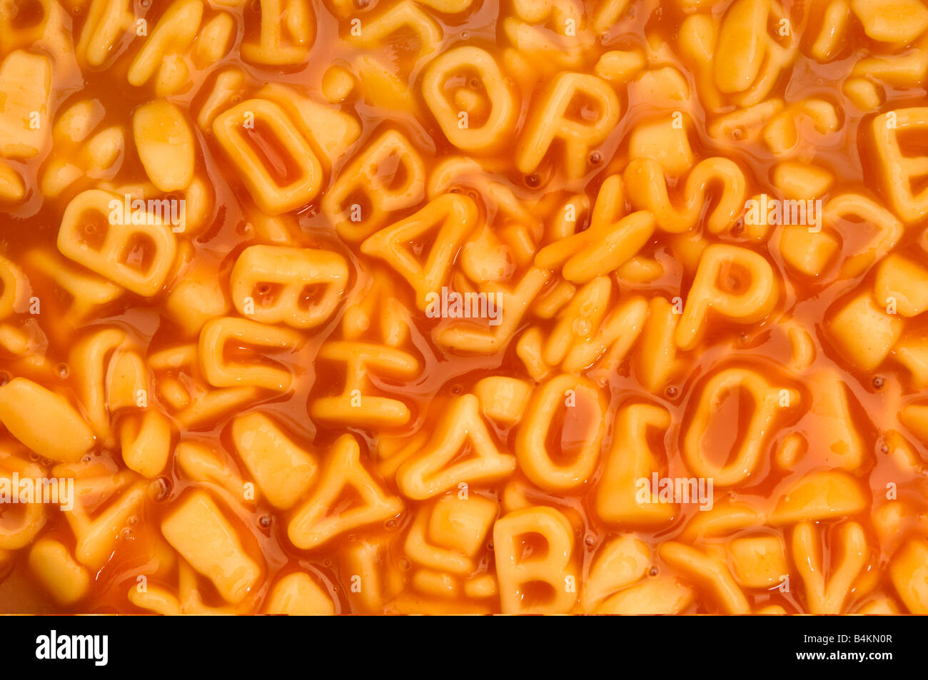 Un contexte de spaghetti alphabet Photo Stock