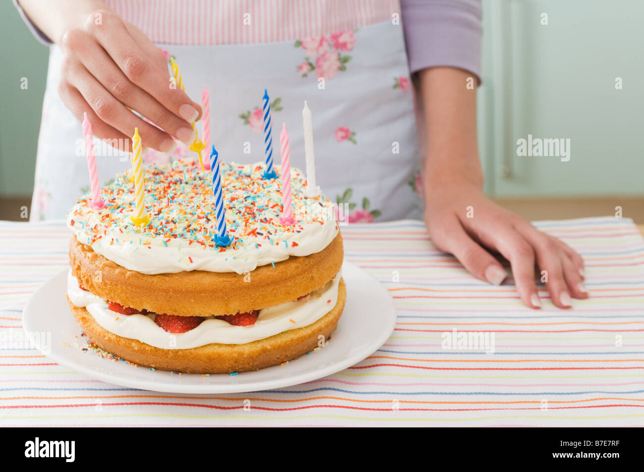 Woman with birthday cake Photo Stock
