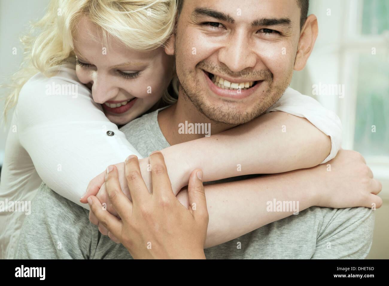 Young woman hugging boyfriend Photo Stock