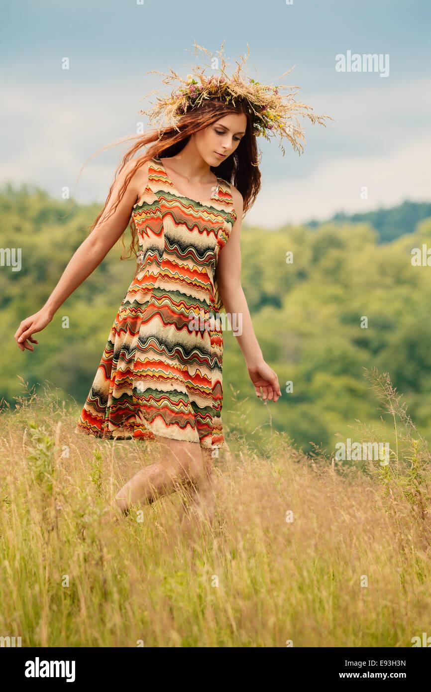 Woman walking in field Photo Stock