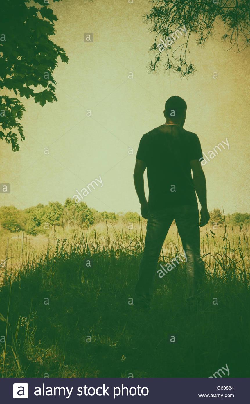 De mystérieux figure masculine dans la lande Photo Stock