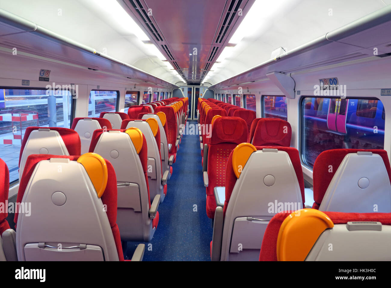 Inside,interior,empty,coach,carriage,seat,red,orange,seats,TOC,train,operating,company,cheap,night,dusk,evening,standard,first,class,herd,Expensive,ticket,price,prices,UK,east,midlands,train,trains,train