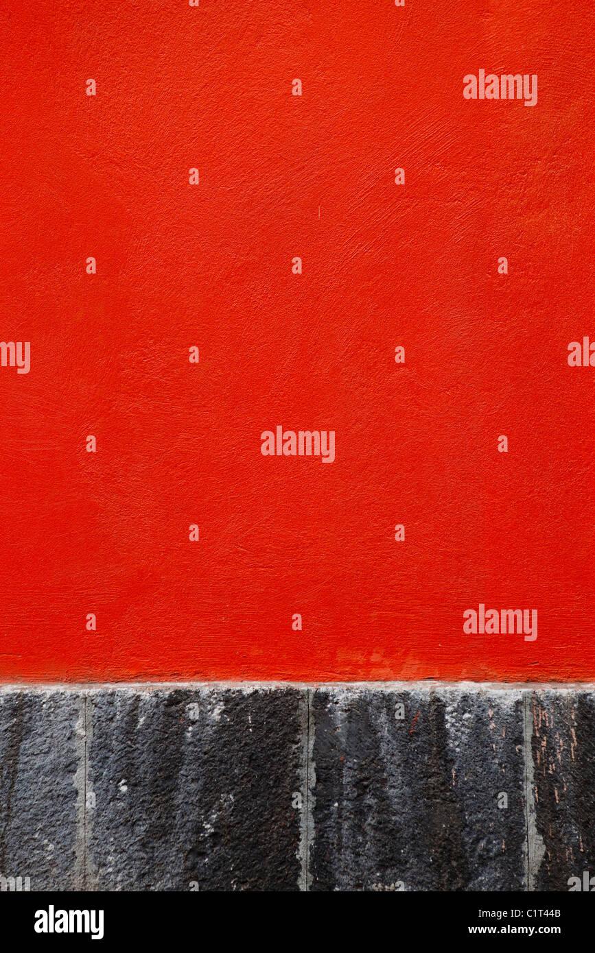 Rosso parete in stucco, close-up Immagini Stock