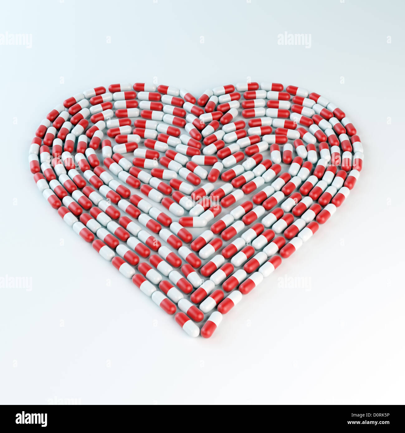 Il bianco e il rosso capsule formando un cuore di shap Immagini Stock