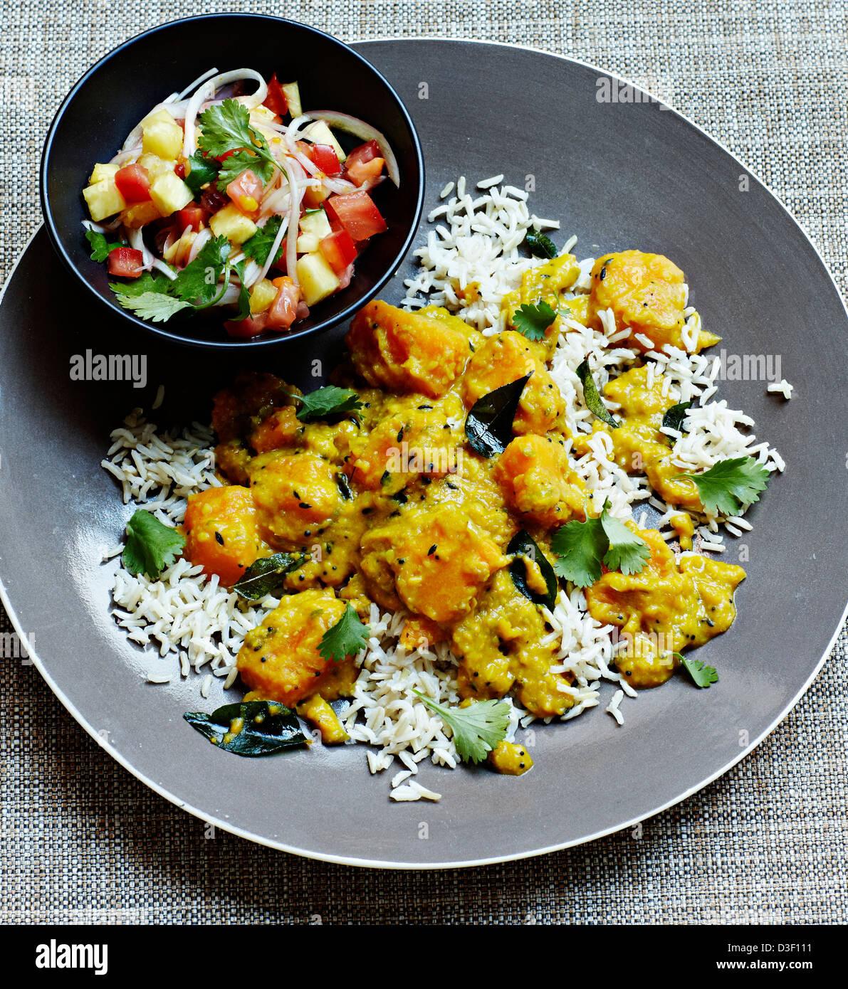 Goa di curry di zucca con salsa rojal Immagini Stock