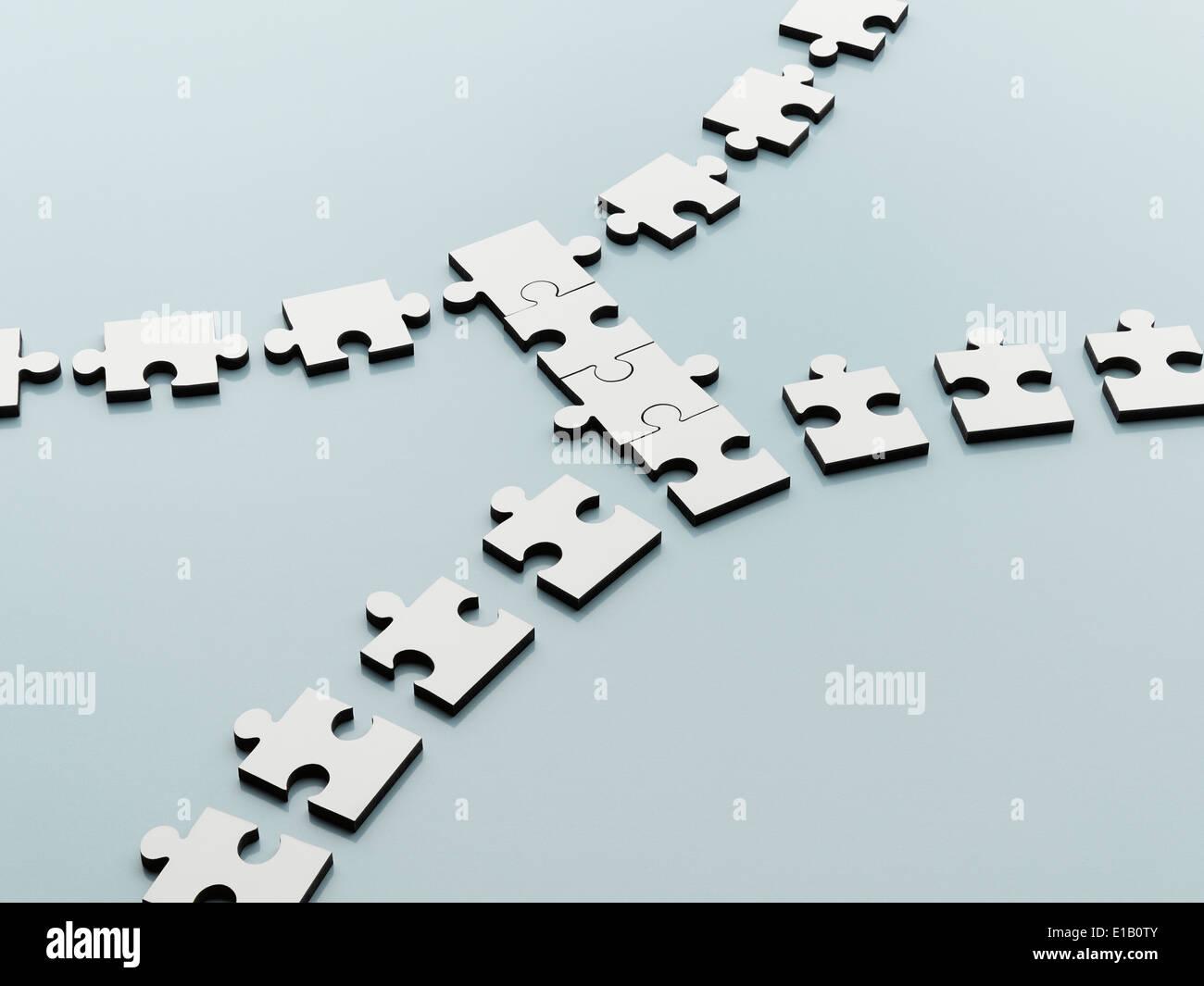 Pezzi di puzzle nel colmare il divario Immagini Stock
