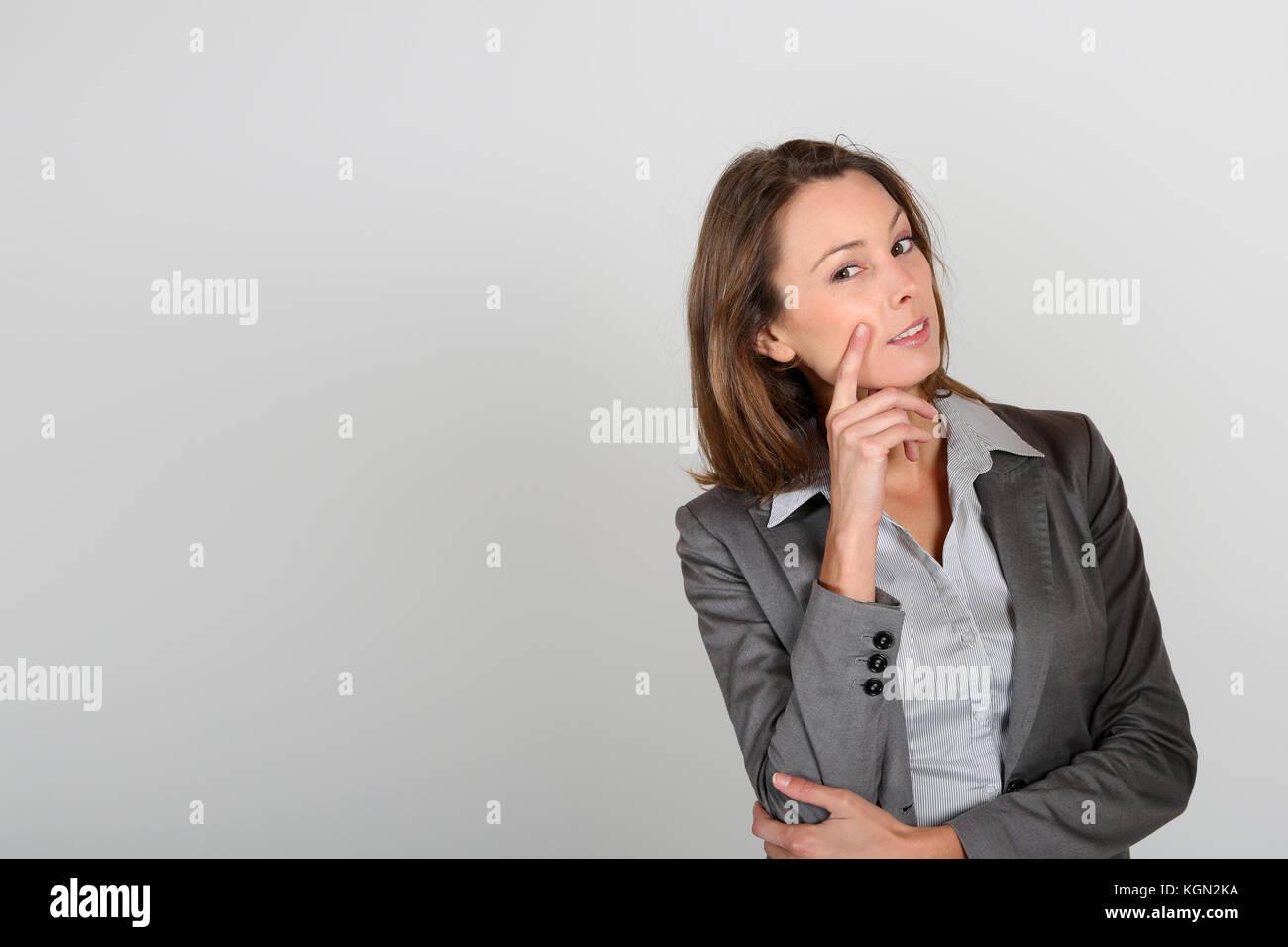 Imprenditrice di dubbia guardare Immagini Stock