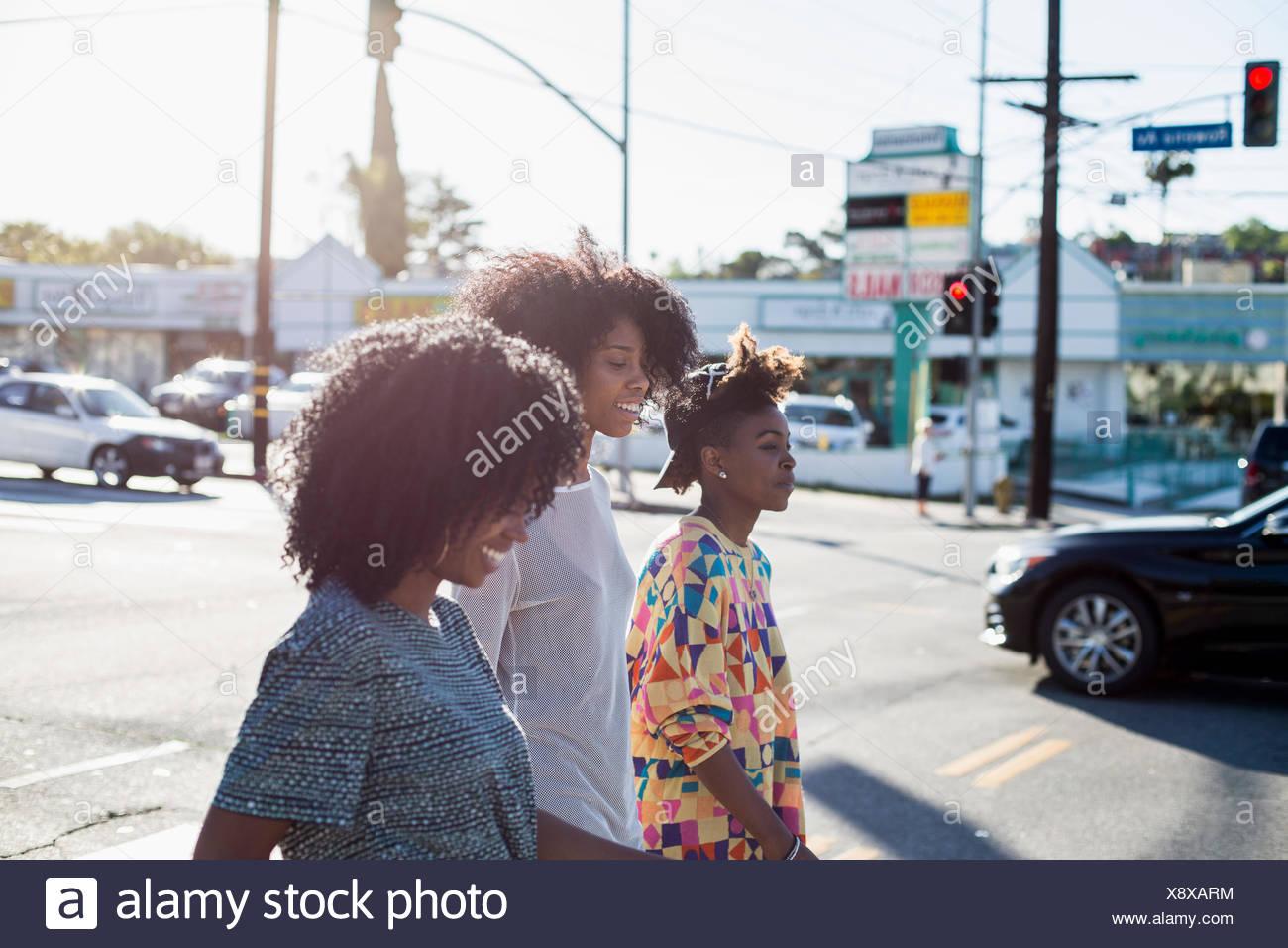 Tre giovani donne. Immagini Stock