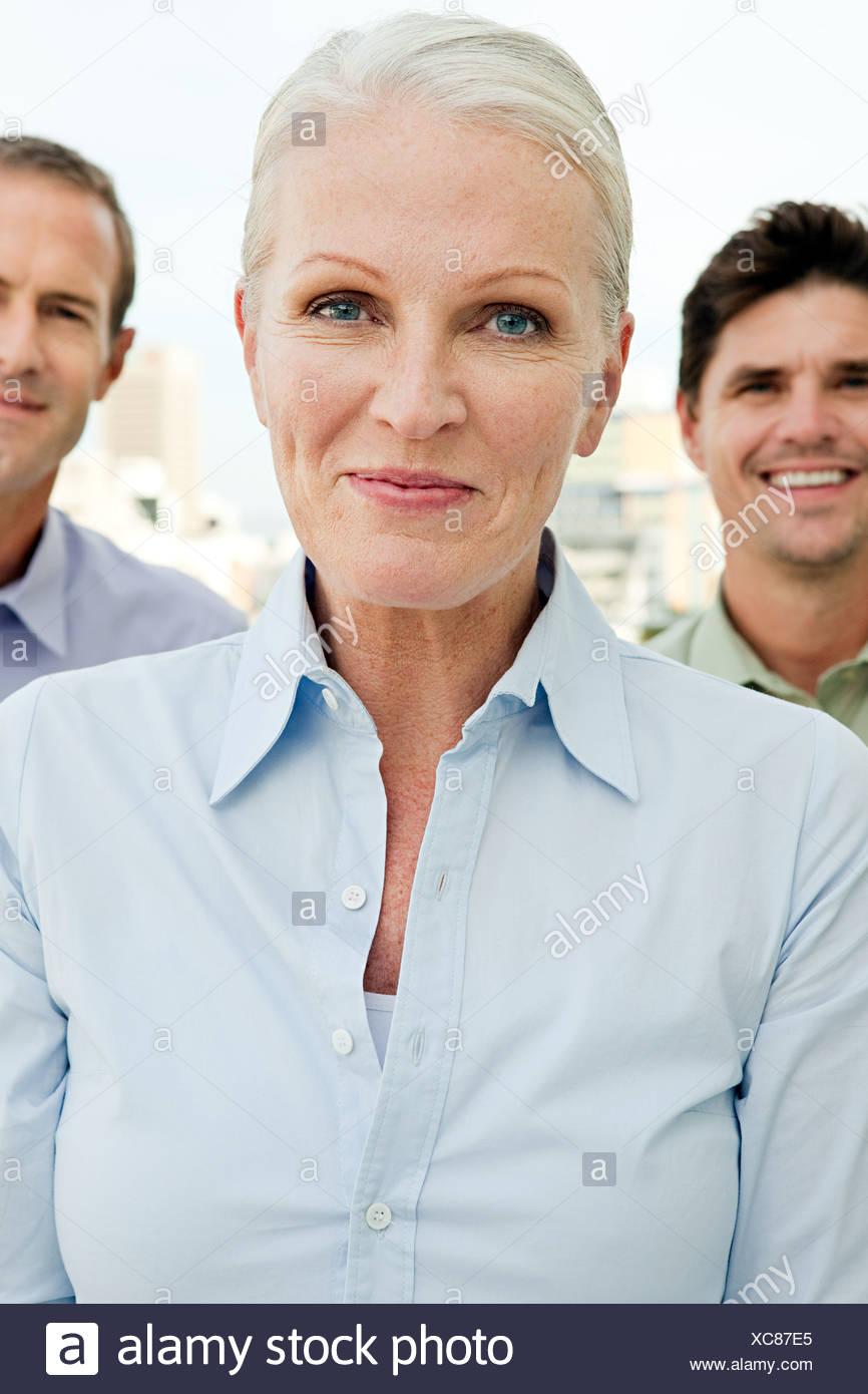 Tre imprenditori, concentrarsi sulla donna Immagini Stock