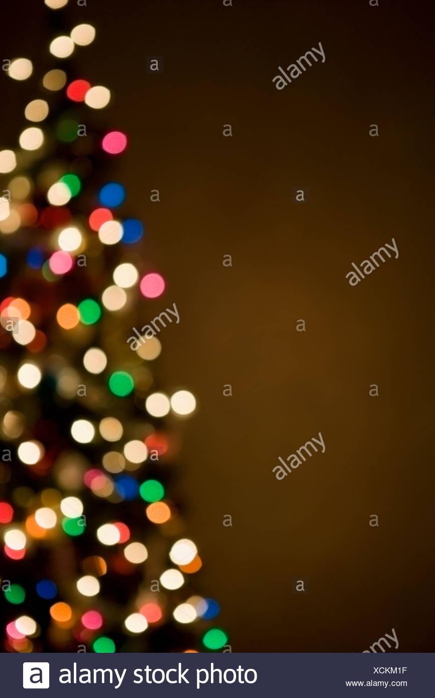 Le luci di Natale sulla struttura, al di fuori della messa a fuoco Immagini Stock