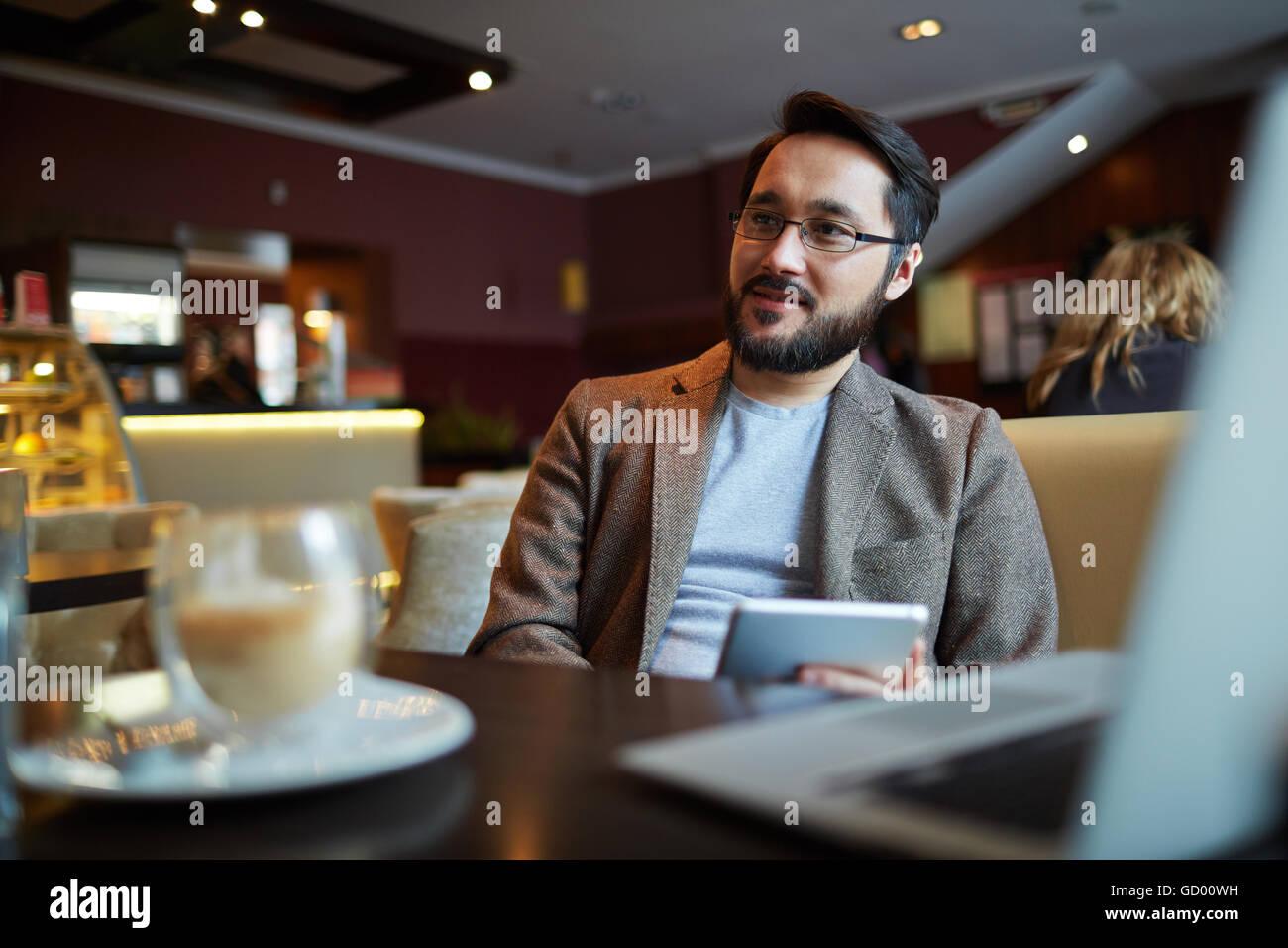 Homem no café Imagens de Stock