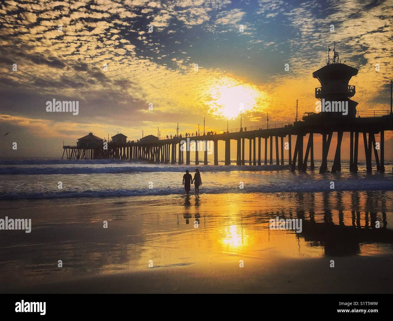 Pôr-do-sol no cais Imagens de Stock