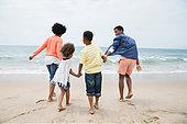 family-holding-hands-on-beach-EWW9C0.jpg