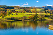 woman-fly-fishes-in-esthwaite-water-in-t