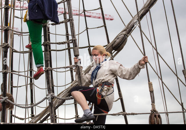 Aarhus, Denmark. 4th July, 2013. Young female crew member during The Tall Ships Races 2013 in Aarhus, Denmark. The - Stock Image