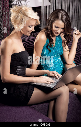 Two pretty girl having fun together - Stock Image