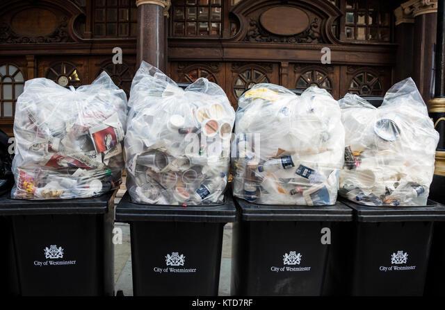 rubbish-bags-towering-in-rubbish-bins-ou