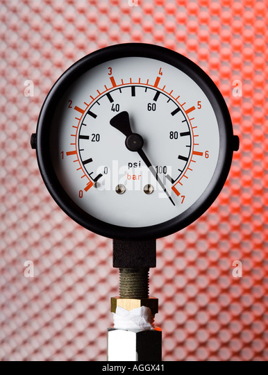 a pressure gauge showing high pressure - Stock Image