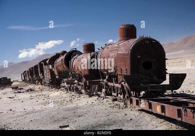 Train cemetery on the edge of Salar de Uyuni in Bolivia - Stock Image