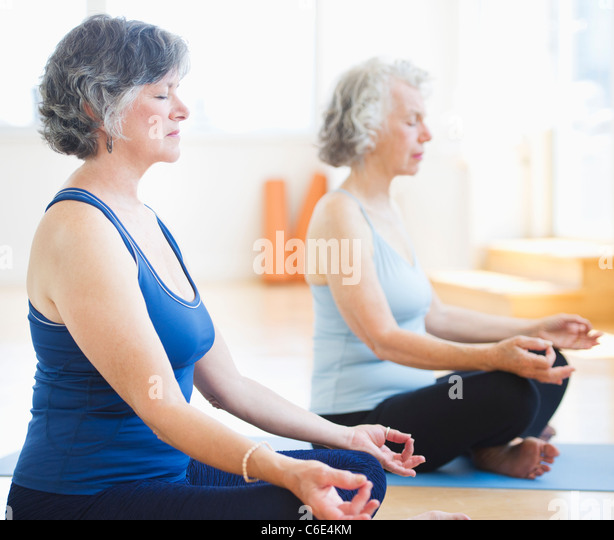 USA, New Jersey, Jersey City, Two senior women practicing yoga - Stock Image