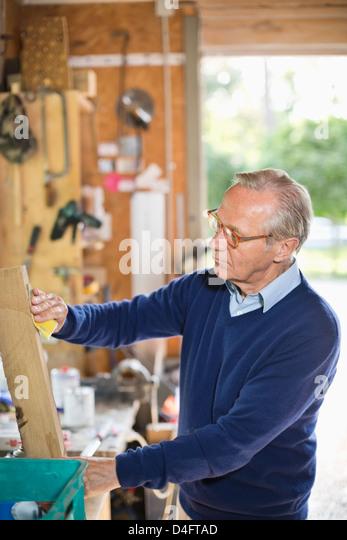 Man working in garage - Stock Image
