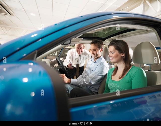 Car salesman and customer