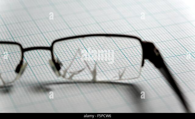 broken-glasses-on-a-graph-paper-backgrou