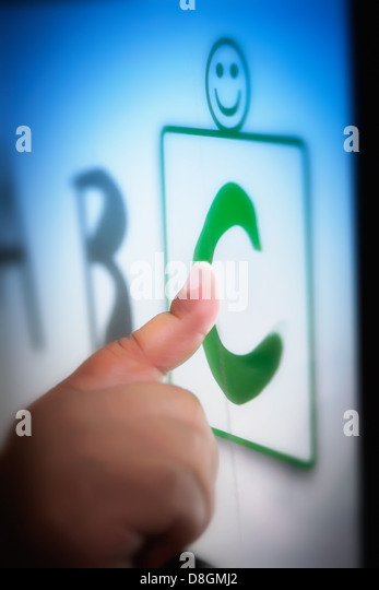 A toddlers' finger on a touchscreen tablet learning the alphabet using educational software. - Stock Image