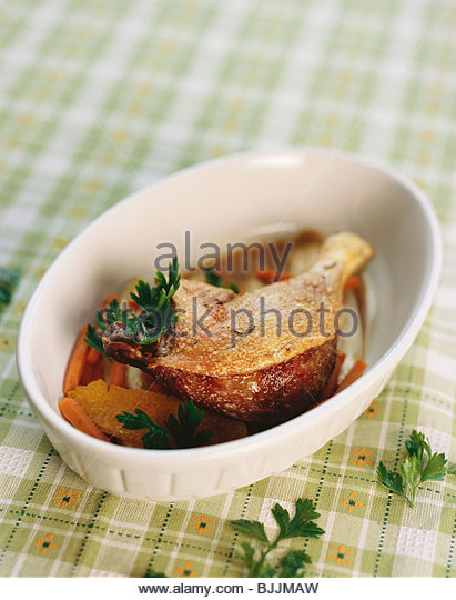 Crispy roast duck leg - Stock Image