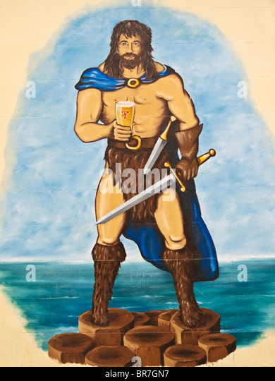 The giant Finn McCool painted on the side of a public house in the town of Bushmills in County Antrim, Northern - Stock Image
