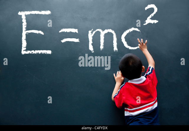 boy drawing E=mc2 on the wall - Stock Image