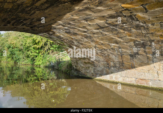reflections-on-underside-of-bridge-f32te