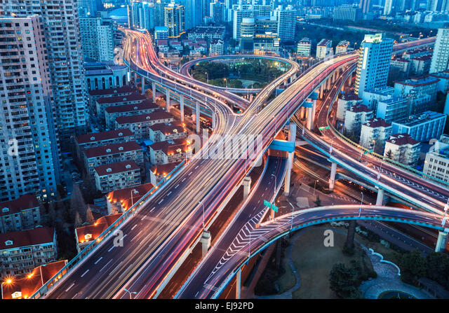 city interchange with tail lights - Stock Image