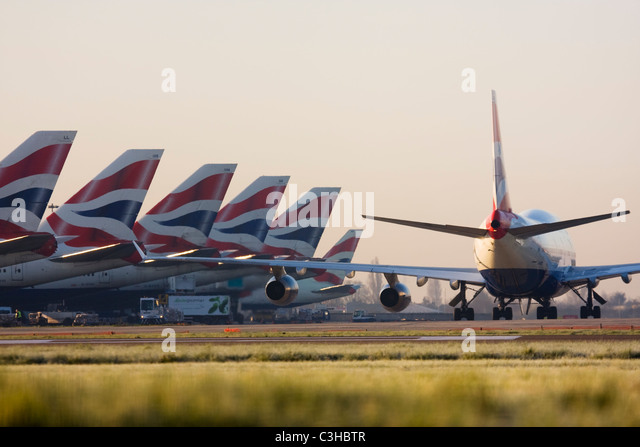Fleet of British Airways airliners at London Heathrow Airport UK - Stock Image