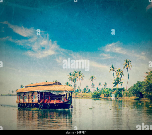 Vintage retro hipster style travel image of travel tourism Kerala background - houseboat on Kerala backwaters with - Stock Image