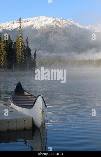 a-canoe-by-a-jetty-on-lac-beauvert-jaspe