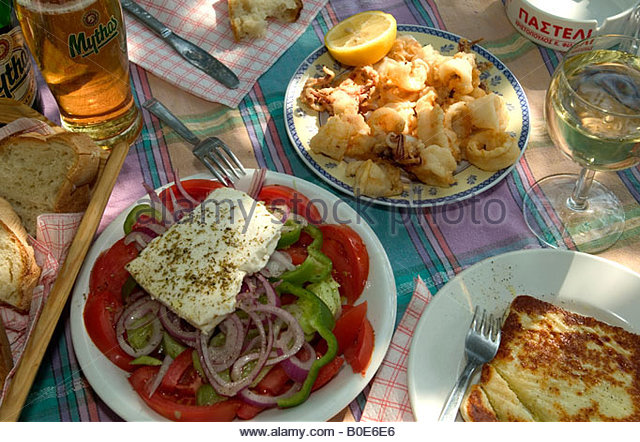 Greek salad,calamares and saganaki served 'alfresco' - Stock Image