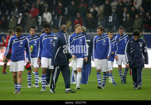 Schalke's players leave the field in disappointment after a Bundesliga game of FC Schalke 04 versus Eintracht - Stock Image