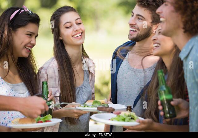 Hipsters have lunch and beers - Stock Image