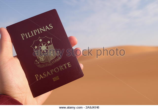 holding-a-philippine-passport-on-a-deser