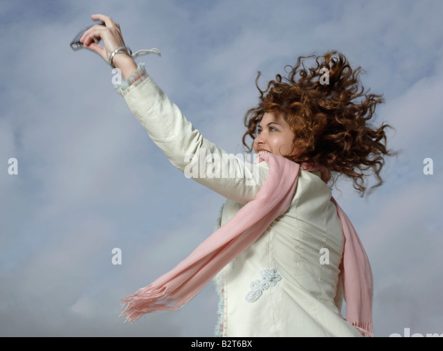 Woman taking self portrait with camera - Stock Image