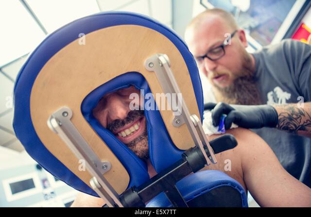 male-customers-face-between-headrest-in-