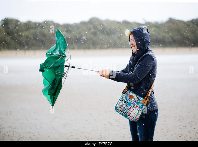 An umbrella blown inside out during a storm - Stock Image