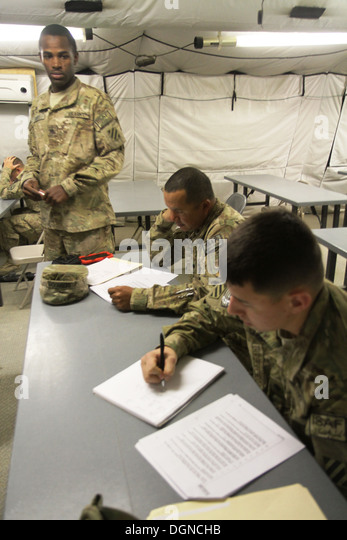 U.S. Army Sgt. Rashad Scott (left), a Boston, Ga., native, and a radiology specialist with 703rd Brigade Support - Stock Image