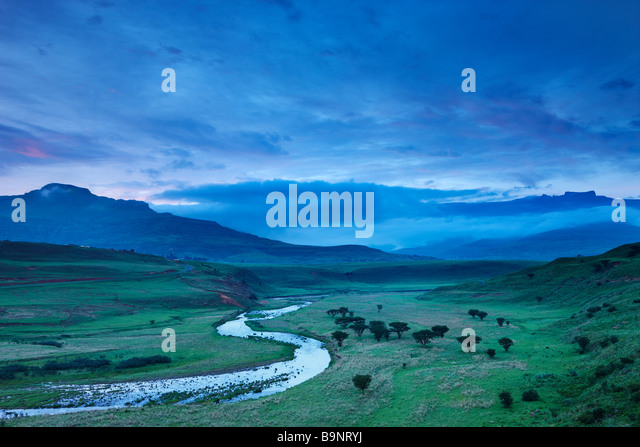 a moody evening sky over the Tugela Valley with the Drakensberg Mountains beyond, KwaZulu Natal, South Africa - Stock Image